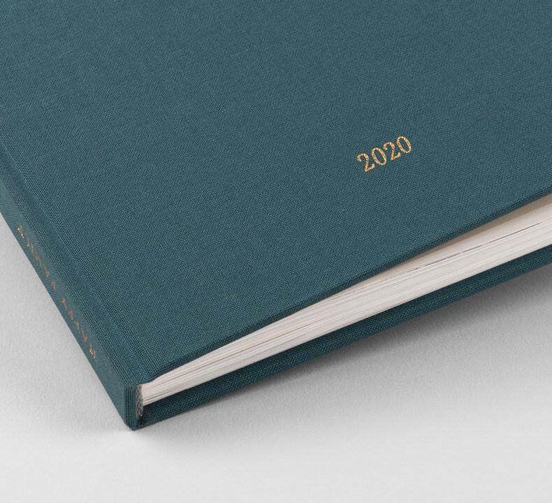 Kreatives Fotobuch mit Stoffeinband